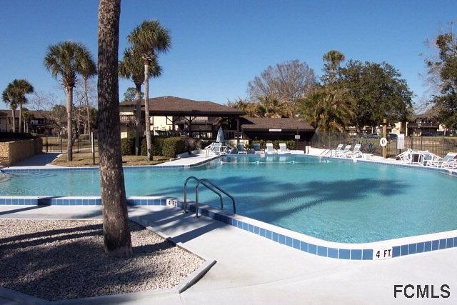 palm club coast condos pool